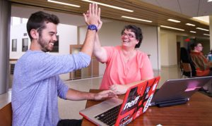 students sharing a high five