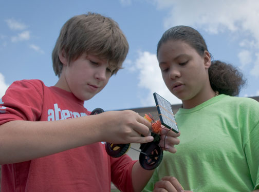 middle school students with solar powered robot