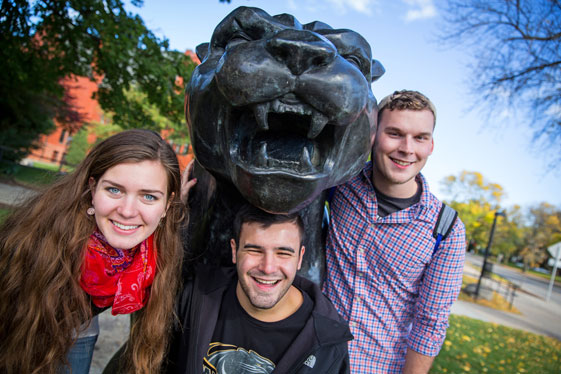 students with panther sculpture