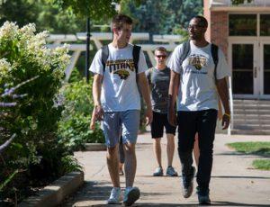students walking on sidewalk